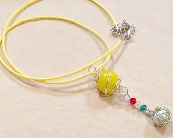 Silver Wire Caged Marble Pendant Necklace With Yellow Cord
