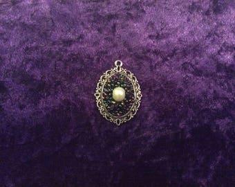 Oval 'space rock' pendant