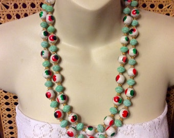 Vintage 1950's made in Hong Kongeye acyrlic double strand.