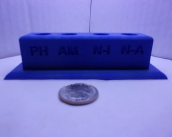 Aquarium water test tube holder with lettering