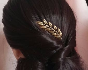 Comb with brass leaf branch