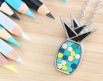 Pineapple Tin pendant made with recycled into the resin colour pencils