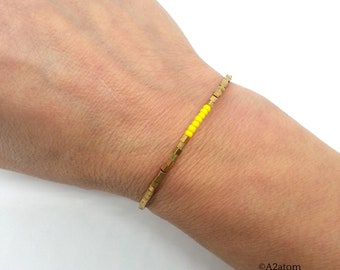 Minimalist women bracelet cube in brass and yellow beads - trendy spring 2018 collection