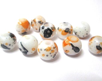 10 white speckled orange and black glass beads 8mm (H-7)