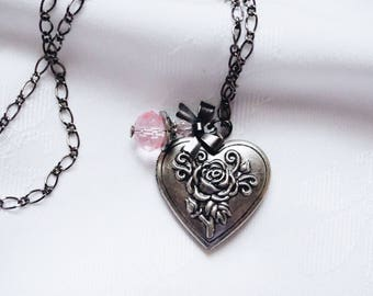 Floral Heart Locket With Pink Charm And Shiny Black Bow