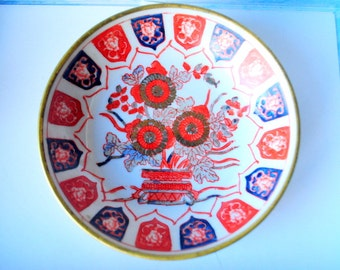 Oriental vintage 70s porcelain decorative plate -bowl with exotic, hand painted  flowers design and brass bottom.
