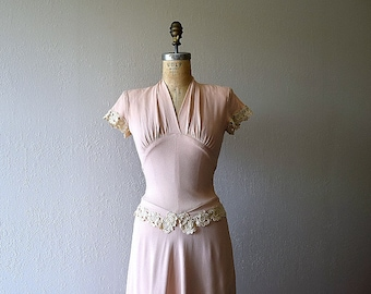 RESERVED . . . 1940s dress . vintage 40s rayon dress