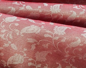 Reversible silver floral paisely pattern on red brocade woven fabric