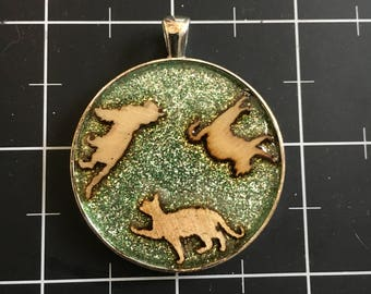 Circling Cats Pendant, 50% of the proceeds go to the current focus animal charity