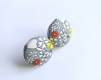 Floral fabric covered button earrings in grey, white, yellow and orange.