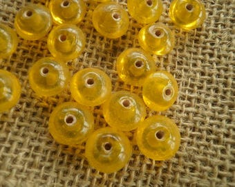 Set of 8 round glass beads, transparent yellow color, size 1.2/0.5 cm