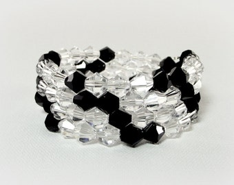 A Crystal Clear Night Bracelet Featuring Sparkling Clear and  Black Crystals