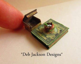 From *DJD* 12th scale miniature natural history book and boxed robin's nest.