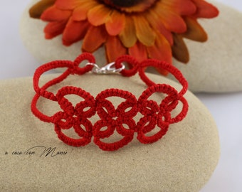 Hand made braided bracelet in red cotton lace