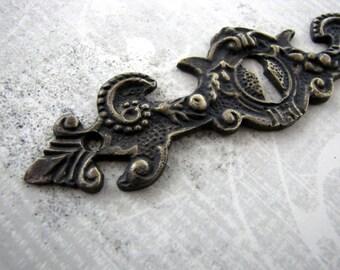 Batavia Antique Style Horizontal Brass Keyhole Escutcheon