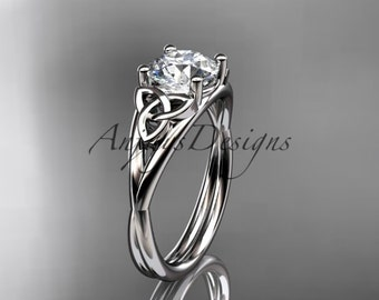"14kt white gold celtic trinity knot wedding ring, engagement ring with a ""Forever Brilliant"" Moissanite center stone CT7189"