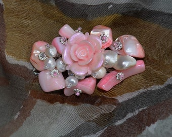 Brooch flower handmade 100% . The brooch is made pearl beads, czech  beads,ceramiks flower and metal beads. Brooch on  metal founding.