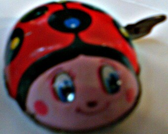 Pink-Faced Lady Bug Vintage Tin Wind Up Toy, 1950s