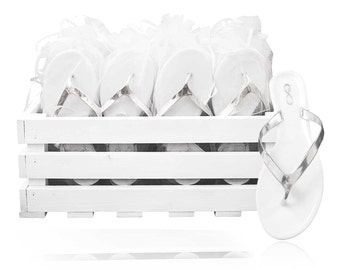 30 white and silver wedding flip flops presented in a beautiful crate