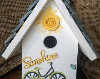 White hand-painted birdhouse with wood accents, hanger and easy clean out bottom. Made in Michigan and fast shipping!
