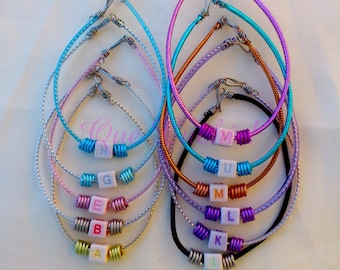 Bracelet with a letter with colored cord