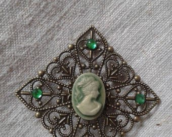Green cameo brooch