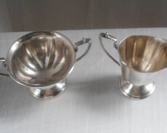 Nickle Silver creamer, and sugar bowel made in USA
