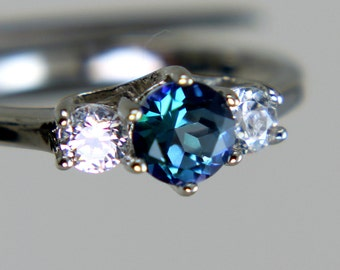 Neptune Garden Topaz Round in an Gleaming Accented Sterling Silver Ring