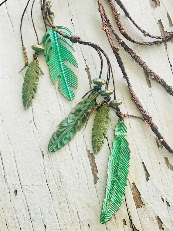 Fly. Brass feathers suspended from braided waxed cord lariat. Handmade and OOAK by ladeDAH! jewelry.