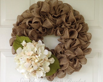 Fall Rustic burlap wreath accented with a cream hydrangea. More colors available- new sizes