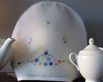 Vintage white tea cosie cover with hand embroidered flowers