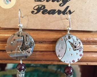 Watchworks earrings with garnet drop