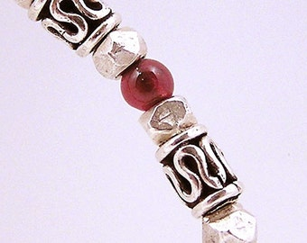 Sterling silver and garnet bangle bracelet