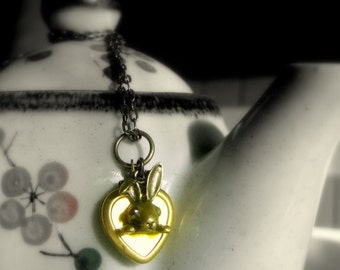 the white rabbit of wonderland. A very romantic real vintage locket heart with a brass rabbit with black glass eyes
