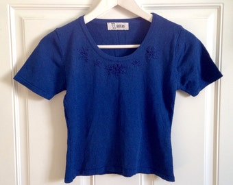 Womens vintage blue short sleeve fitted crop top with floral embellishment by Sisters