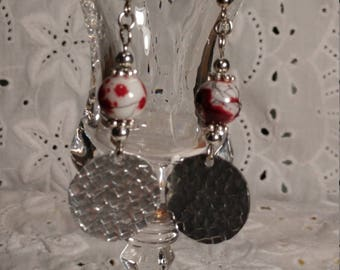 Handmade silver tone hammered disc earrings with red, black and white glass beads