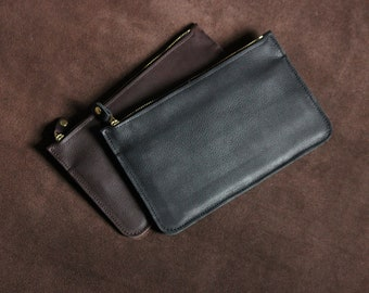 Leather Pouch - for carrying your everyday essentials. Zip Closure, coin section and 6 cardholder slots