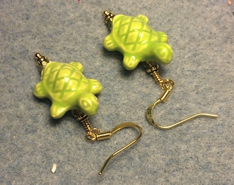 Lime green ceramic turtle bead earrings adorned with lime green Chinese crystal beads.