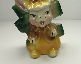 Vintage yellow ceramic, mid century modern, easter bunny planter from the 1950s-1960s.