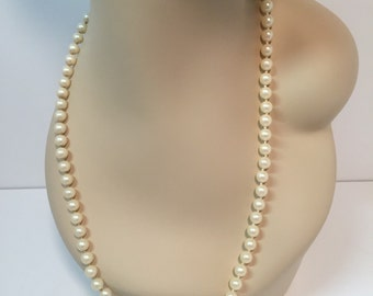 Vintage Japan pearl necklace with floral clasp