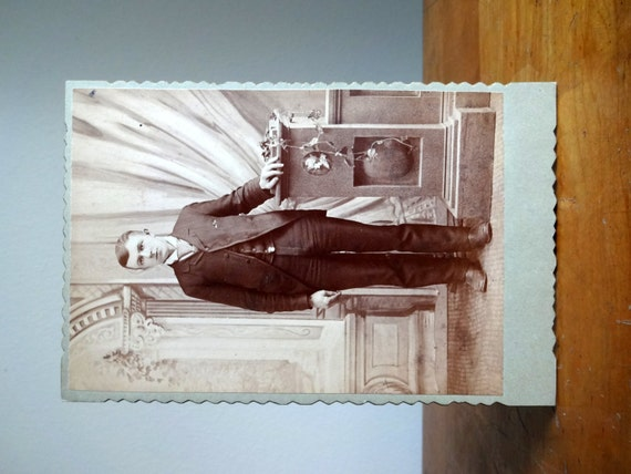 Vintage 1900's photograph postcard of a young man with a prosthetic leg