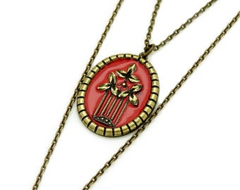 Necklace with ornate frame and Red enamel