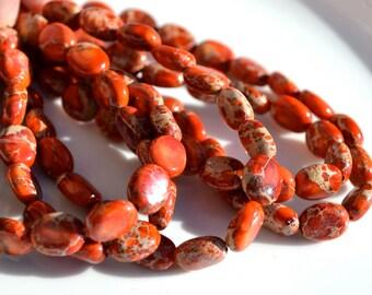 Orange Impression Jasper Small Oval Beads  8 inch strand