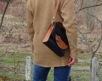 Handbag for women with detachable, adjustable shoulder strap, creation from Quebec and tan, dark grey stiff leather, hand stitched to the Canada.