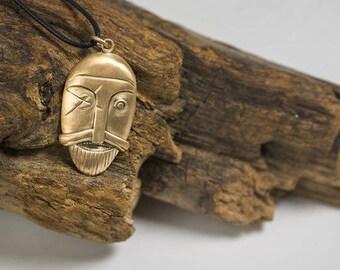 Pendant, Odin, bronze, silver, gold.
