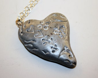Silver Polymer Embossed Heart Pendant