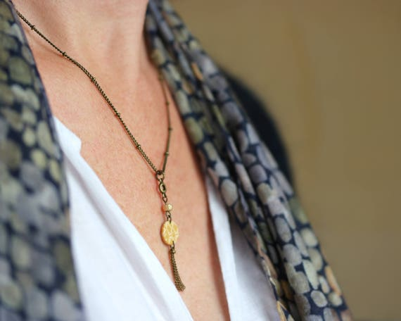 Boho style necklace, spicy yellow round medal with handmade patterns, golden bead and brass tassels 'Mahonia'