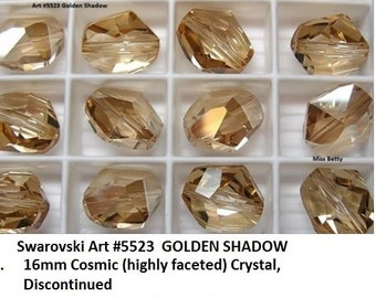 4 Swarovski Art #5523 CRYSTAL GOLDEN SHADOW 16mm by 12mm Cosmic Crystal. New from Package
