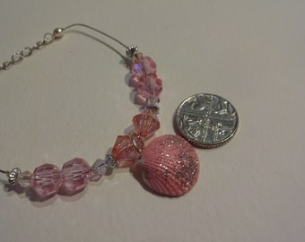 """shell bracelet brand new, lovely sparkly pink, pink matching beads and and clear crystals adjustable length 5/6 """" length s/p lobster clasp"""