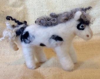 Little felted wool pony .